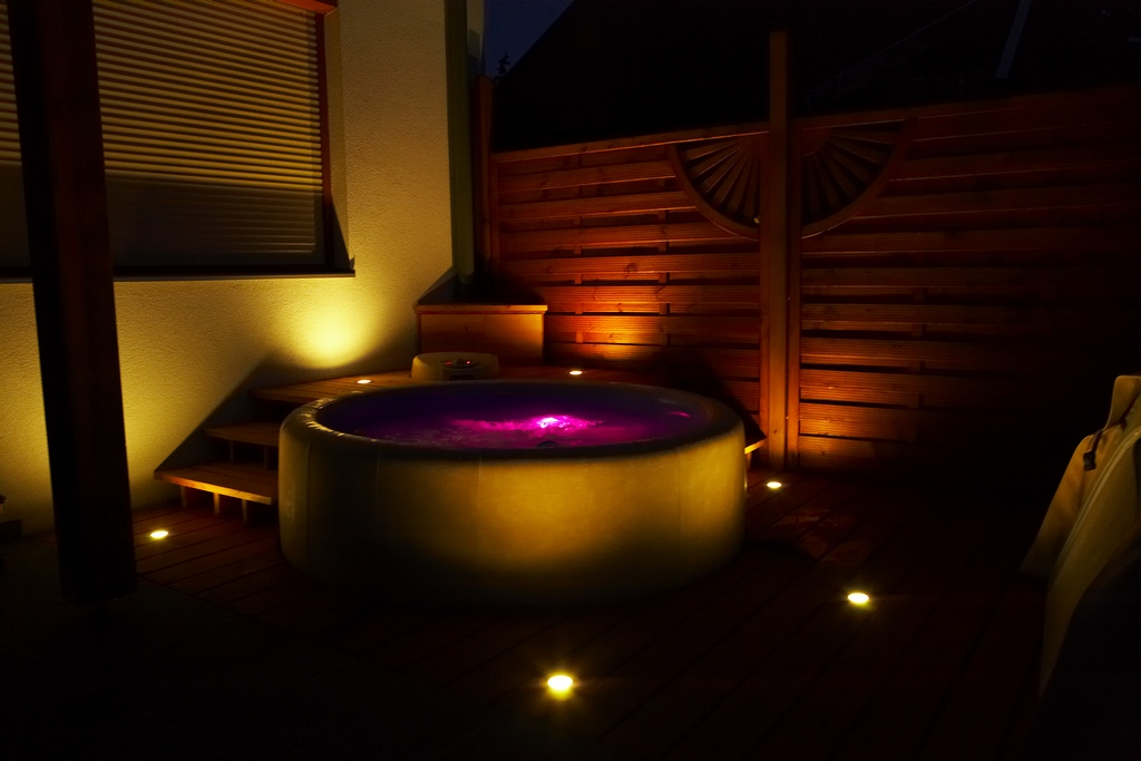 Softub hot tub at night